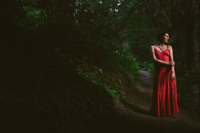 Beautiful red dress, dramatic light, forest and nature, dramatic portrait